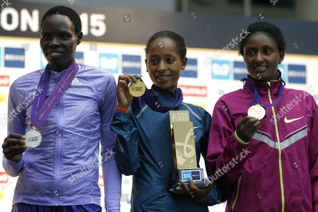 Birhane Dibaba (c) of Ethiopia Celebrates on the Podium After Winning the Women's Race of the Tokyo Marathon 2015 in Tokyo Japan 22 February 2015 Dibaba Won the Race Ahead of Second-placed Helah Kiprop (l) of Kenya and Third-placed Tiki Gelana (r) of Ethiopia Some 36 000 Runners Took Part in the Ninth Running of the Tokyo Marathon One of the Six World Marathon Majors (wmm) Japan Tokyo