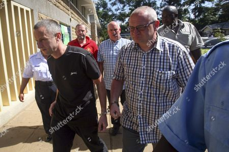 (l-r) Handcuffed in Pairs British Nationals Paul Abbott Ian Glover Eddie Swift Steve Gibson Are Escorted by Police Officers After They Were Sentenced to Pay a Fine Or Serve a Prison Sentence at Makadara Law Court in Nairobi Kenya 21 March 2016 the Four Britons Were Sentenced Each to Pay 200 000 Kenya Shillings (approx 1 970 Us Dollars) For Unauthorizied Trespassing and Photographing Aircraft Or Serve One Year in Prison They Were Arrested at Nairobi's Wilson Airport on Suspicion of Terror Offences on 12 March 2016 the Men Were on a Plane-spotting Trip to Africa and Were Visiting Ethiopia Before Arriving in Kenya a Report Said Kenya Nairobi