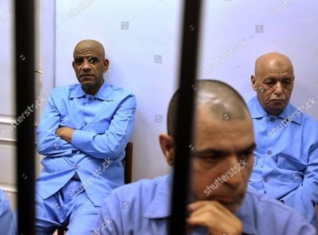 Stock Image of Former Head of Intelligence Abdullah Al-senussi (l) Under the Deposed Dictator Muammar Gaddafi Attends His Trial on Charges of Crimes Linked to the 2011 Revolution in Tripoli Libya 28 July 2015 According to Local Reports As Well As Sentencing the Former Dictator's Son in Absentia Saif Al-islam Gaddafi and Al-senussi to Death Over 30 Associates of Gaddafi Received Sentences Between Seven Years in Jail to Life and Death Libyan Arab Jamahiriya Tripoli