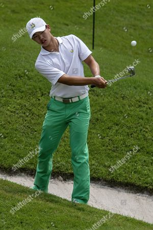 Stock Image of Guan Tianlang of China Hits a Shot During the Round One of the Cimb Classic Golf Tournament in Kuala Lumpur Malaysia in Kuala Lumpur Malaysia 30 October 2014 Malaysia Kuala Lumpur