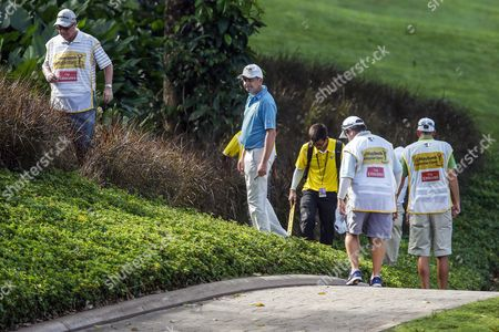 Stock Photo of Peter Lawrie of Ireland (2-r) Searches For His Ball During the Third Round of Malaysian Open Golf Tournament in Kuala Lumpur Malaysia 07 February 2015 the Tournament is Held From 05 - 08 February 2015 Malaysia Kuala Lumpur