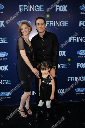L-R: Kiersten Warren, Kirk Acevedo and daughter attend