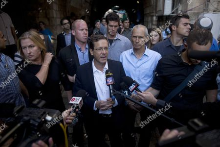 Israeli Leader of the Oppposition Isaac Herzog (c) and Tzipi Livni (l) Speak with the Press at the Scene of an Attack on a Jewish Family on 03 October in Jerusalem Israel 08 October 2015 There Have Been Increasing Clashes in Recent Weeks Between Israelis and Palestinians Amid a Rift Over the Use of the Flashpoint Site Called the Temple Mount by Jews and the Noble Sanctuary by Muslims Which Lies in Jerusalem's Old City Israel Jerusalem
