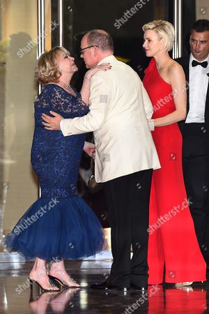 Michele Mercier Greets Prince Albert Ii of Monaco (c) and His Wife Princess Charlene (r) at the 67th Red Cross Ball at the Sporting Club Salle Des Etoiles in Monaco 25 July 2015 the Traditional Charity Event is Held Annually in the Principality of Monaco Monaco Monaco