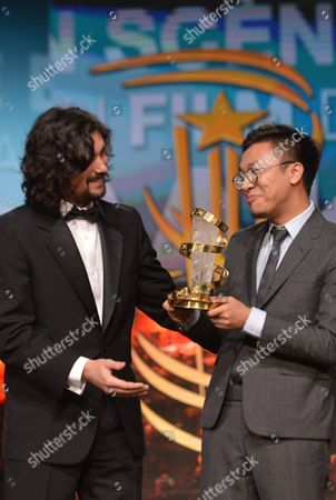 Chinese Producer Wang Zijian (r) Receives the Prize For Best Directing From Jury Member Lisandro Alonso (l) For the Film 'Knife in the Clear Water' During the Award Ceremony of the 16th Marrakesh International Film Festival in Marrakesh Morocco 10 December 2016 Morocco Marrakech