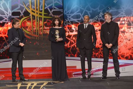Romanian Director Cristian Mungiu (l) French Actress Isabelle Adjani (2-l) Mauretanian Director Abderrahmane Sissako (2-r) and French Director Christophe Honore (r) Stand on Stage During a Tribute to Isabelle Adjani at the 16th Annual Marrakech International Film Festival in Marrakech Morocco 09 December 2016 the Festival Runs From 02 to 10 December Morocco Marrakech