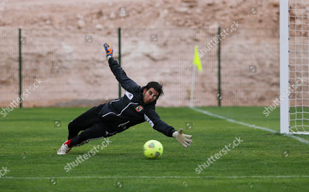 Al Ahly Sc Goalkeeper Sherif Ekramy Performs During His Team's Training Session in Agadir Morocco 10 December 2013 Al Ahly Sc Will Face Guangzhou Evergrande Fc in the Fifa Club World Cup Quarter Final Soccer Match on 14 December 2013 Morocco Agadir