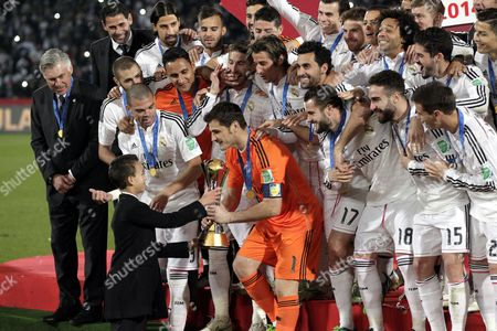 Prince Moulay El Hassan of Morocco (front L) Hands Over the Trophy to Ilker Casillas (c) As the Real Madrid Team Looks on During the Awarding of the Winner of the Fifa Club World Cup 2014 Between San Lorenzo of Argentina and Real Madrid of Spain in Marrakech Morocco 20 December 2014 Morocco Marrakech