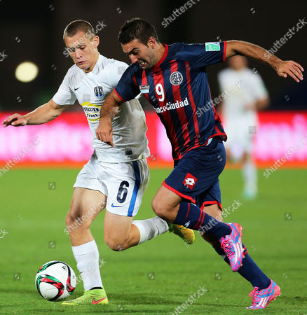 Martin Cauteruccio (r) of San Lorenzo in Action Against John Irving (l) of Auckland City Fc During the Fifa Club World Cup 2014 Semi Final Soccer Match Between San Lorenzo and Auckland City Fc in Marrakech Morocco 17 December 2014 Morocco Marrakech