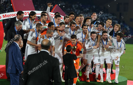 Prince Moulay El Hassan of Morocco (front C Back to Camera) Hands Over the Trophy to Iker Casillas (c in Orange Dress) As the Real Madrid Team Looks on During the Awarding of the Winner of the Fifa Club World Cup 2014 Between San Lorenzo of Argentina and Real Madrid of Spain in Marrakech Morocco 20 December 2014 Morocco Marrakech