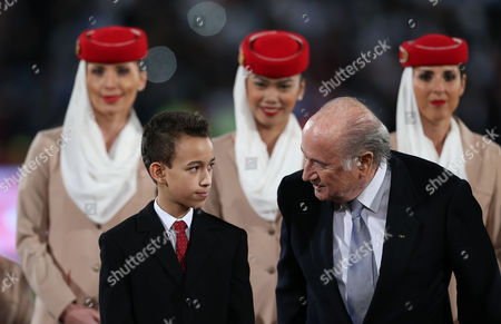 Prince Moulay El Hassan of Morocco (l) and Joseph Blatter (r) President of Fifa Are Pictured During the Fifa Club World Cup 2014 Final Soccer Match Between San Lorenzo of Argentina and Real Madrid of Spain in Marrakech Morocco 20 December 2014 Morocco Marrakech