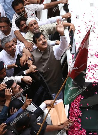 Stock Picture of Former Pakistani Prime Minister Yousuf Raza Gilani (c) Waves to Supporters Upon His Arrival at the Banking Court For a Hearing in a Corruption Case in Karachi Pakistan 07 September 2015 According to Media Reports a Federal Anti-corruption Court on 07 September Granted Bail to Former Prime Minister Yousuf Raza Gilani in His Alleged Involvement in Several Cases Relating to a Multi-billion Trade Subsidy Scam Pakistan Karachi