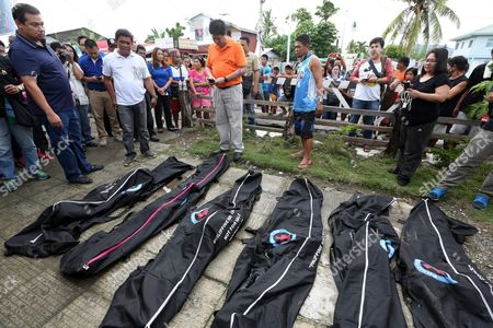 Stock Picture of Filipino Legislator Martin Romualdez (l) with Tacloban City Mayor Alfred Romualdez (3-l) Inspect Newly Recovered Bodies of Typhoon Victims Found at a Damaged School in Tacloban City Leyte Island Philippines 07 November 2015 Six Bodies Were Recovered in Tacloban City Which was Worst Hit by Super Typhoon Haiyan According to Mayor Alfred Romualdez Haiyan Hit the Country in November 2013 Killing More Than 6 300 People Philippines Tacloban City