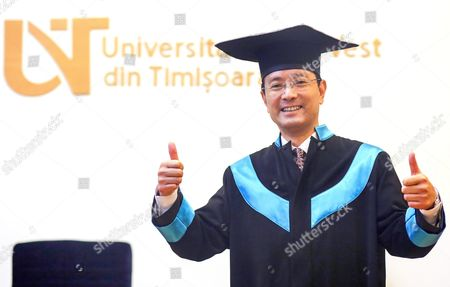 Stock Picture of Chinese Professor Ye Qing Jsd the Director of Research Center For Procedure Law of China University of Political Science and Law and Vice President of Shanghai Academy of Social Sciences Gestures While Delivering a Speech in Front of Romanian Students Shortly After He was Awarded with the Title 'Doctor Honoris Causa Legum Scientiae' at the Western University of Timisoara City 500 Km North-west From Bucharest Romania 15 October 2015 Romania Timisoara