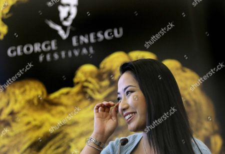U S Classical Violinist Sarah Chang Gestures During a Press Conference Dedicated to the Opening of the George Enescu International Festival and Competition at Palace Hall in Bucharest Romania 29 August 2015 George Enescu Festival Held Since 1958 at Each Two Years is the Biggest Classical Music Festival Held in Romania in the Honor of the Famous Romanian Composer and Violinist Gorge Enescu the Opening Concert Which Will Be Performed by Romanian Youth Orchestra and Childern Choir of the Romanian Radio Broadcasting Society Will Be Directed by Jarvi About 2 500 Foreign Artists and 500 Romanian Will Join the 2015 Edition Which Starts on 30 August and Ends on 20 September Romania Bucharest