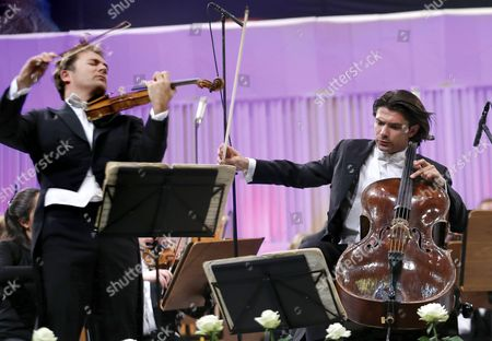 French Cellist Gautier Capucon (r) and His Brother Renaud Capucon (l) on Violin Accompanied by London Symphony Orchestra Perform Brahms' 'Double Concerto For Violin Cello and Orchestra' on the Palace Hall Stage in Bucharest Romania 09 September 2015 During the Enescu Festival 2015 the George Enescu Festival Held Since 1958 Every Two Years is the Biggest Classical Music Festival Held in Romania in Honor of Famous Romanian Composer and Violinist George Enescu Romania Bucharest
