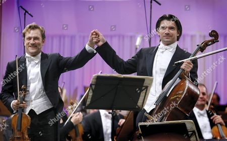 French Cellist Gautier Capucon (r) and His Brother Renaud Capucon (l) on Violin Accompanied by London Symphony Orchestra Salute the Audience After Performing Brahms' 'Double Concerto For Violin Cello and Orchestra' on the Palace Hall Stage in Bucharest Romania 09 September 2015 During the Enescu Festival 2015 the George Enescu Festival Held Since 1958 Every Two Years is the Biggest Classical Music Festival Held in Romania in Honor of Famous Romanian Composer and Violinist George Enescu Romania Bucharest
