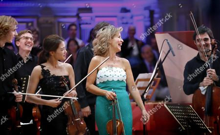 German Violinist Anne-sophie Mutter (c) Surrounded by Mutter Virtuosi Young Musicians Smiles After Performing on the Stage of Romanian Athenaeum Concert Hall During the George Enescu International Festival in Bucharest Romania 09 September 2015 the George Enescu Festival Held Since 1958 Every Two Years is the Biggest Classical Music Festival Held in Romania in Honor of Romanian Composer and Violinist George Enescu Romania Bucharest