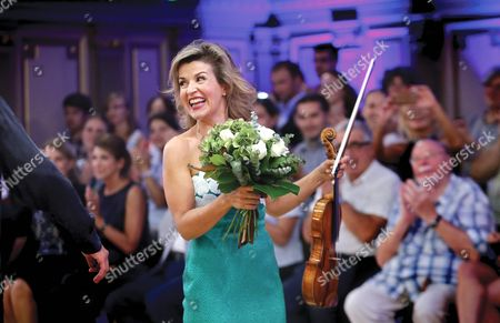 German Violinist Anne-sophie Mutter Smiles While Being Applauded at the End of Her Concert on the Stage of Romanian Athenaeum Concert Hall During the George Enescu International Festival in Bucharest Romania 09 September 2015 the George Enescu Festival Held Since 1958 Every Two Years is the Biggest Classical Music Festival Held in Romania in Honor of Romanian Composer and Violinist George Enescu Romania Bucharest