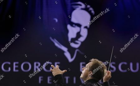 Stock Image of Russian Conductor Vasily Petrenko Conducts the Royal Liverpool Philharmonic Orchestra on the Stage of Palace Hall in Bucharest Romania 17 September 2015 During the Enescu Festival 2015 the George Enescu Festival Held Since 1958 Every Two Years is the Biggest Classical Music Festival Held in Romania in Honor of Famous Romanian Composer and Violinist George Enescu Romania Bucharest