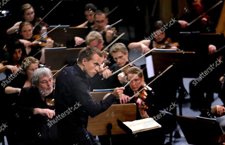 Russian Conductor Vasily Petrenko (c) Conducts the Royal Liverpool Philharmonic Orchestra on the Stage of Palace Hall in Bucharest Romania 17 September 2015 During the Enescu Festival 2015 the George Enescu Festival Held Since 1958 Every Two Years is the Biggest Classical Music Festival Held in Romania in Honor of Famous Romanian Composer and Violinist George Enescu Romania Bucharest