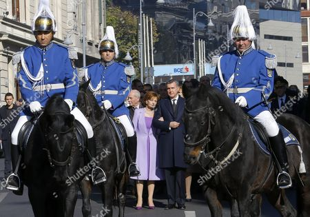 Their Royal Highnesses Crown Princess Margareta of Romania (center L) and Prince Radu ( Center R) Follows the Procession As Romanian Gendarms on Horses Escort the Silver Casket Containing the Heart of Queen Marie of Romania (not Seen) During a Ceremony in Which National History Museum is Handling the Box Hosting the Preserved Heart of the Last Queen of Romania to Her Royal Family in Order to Reach Its Final Resting Place the Peles Castle where She Died Situated at 140 Km North From Bucharest Romania 03 November 2015 the Silver Box with the Heart of Queen Maria Born As Marie Alexandra Victoria - the Niece of Queen Victoria of England - was First Deposited at Her Summer Castle in Balchik at the Black Sea Located in Bulgaria As the Queen Desired in 1940 As Romania Returned the Region of Balchik to Bulgaria the Silver Box was Moved to Bran Castle Central Romania and Deposited in the Castle?s Wooden Church in 1941 the Box was Placed in a Special Crypt Cut Into the Rock of the Mountain Magura Branului in 1968 During the Communist Regime the Grill of the Crypt From the Bran Mountain was Damaged and the Queen?s Heart was Placed in the Treasury House of Bran Castle Museum in 1971 It was Transferred at the National Hystory Museum where the Bigger Box was on Display But the Heart Itself was Preserved Separately Queen Maria was Crowned in 1922 and Died in 1938 when She was 62 Her Heart was Embalmed As Her Last Will Placed in a Silver Box and Wrapped in Two Flags: Romania?s and Britain?s Hundreds of People Gathered to Attend the Special Ceremony in Romania's Capital As the Honor Guard Military Brass Band Sang the Old Royal Anthem Romania Bucharest