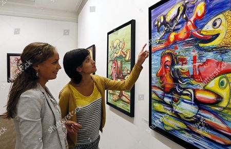Visitors Look at the Painting 'Fisherman: Night Catch' by Painter and Writer Pal Sarkozy in Moscow Russia 20 August 2015 Pal Sarkozy is the Father of Former French President Nicolas Sarkozy Russian Federation Moscow