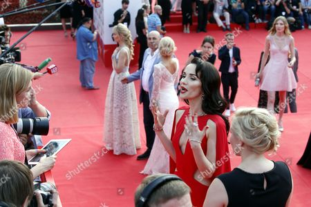 Uruguayan Actress and Singer Natalia Oreiro (r) Arrives on the Red Carpet For the Closing Award Ceremony the 38th Moscow International Film Festival at the Rossiya Theatre in Moscow Russia 30 June 2016 Russian Federation Moscow