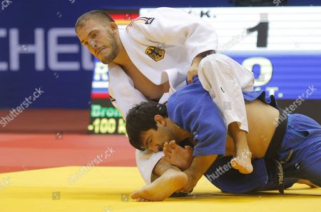 Stock Photo of Karl-richard Frey of Germany (white) in Action Against Tagir Khaibulaev of Russia (blue) During the Men's -100kg Category Bronze Medal Bout at the Judo World Championships at the Traktor Arena in Chelyabinsk Russia 30 August 2014 Russian Federation Chelyabinsk