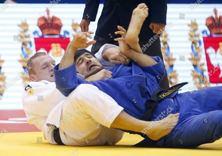 Stock Image of Karl-richard Frey of Germany (white) in Action Against Tagir Khaibulaev of Russia (blue) During the Men's -100kg Category Elimination Bout at the Judo World Championships at the Traktor Arena in Chelyabinsk Russia 30 August 2014 Russian Federation Chelyabinsk