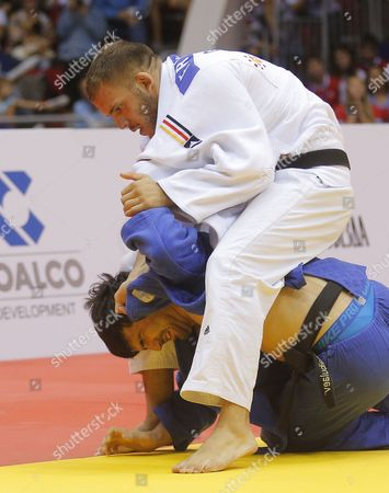 Karl-richard Frey of Germany (white) in Action Against Tagir Khaibulaev of Russia (blue) During the Men's -100kg Category Bronze Medal Bout at the Judo World Championships at the Traktor Arena in Chelyabinsk Russia 30 August 2014 Russian Federation Chelyabinsk