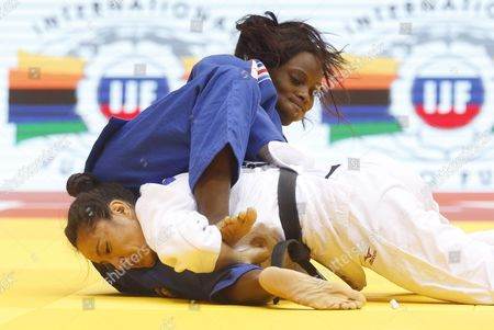 Priscilla Gneto of France (blue) in Action Against Oritia Gonzalez of Argentina (white) During the Women's -52kg Category Elimination Bout at the Judo World Championships at the Traktor Arena in Chelyabinsk Russia 26 August 2014 Russian Federation Chelyabinsk