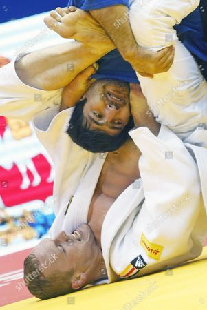 Dimitri Peters of Germany (white) in Action Against Tagir Khaibulaev of Russia (blue) During the Men's -100kg Category Elimination Bout at the Judo World Championships at the Traktor Arena in Chelyabinsk Russia 30 August 2014 Russian Federation Chelyabinsk