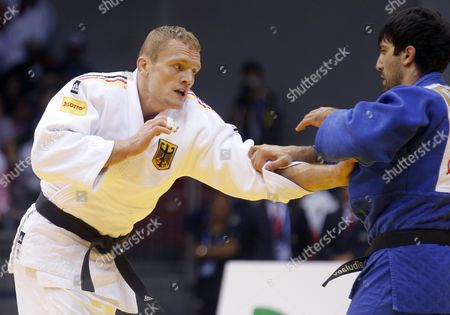 Stock Picture of Dimitri Peters of Germany (white) in Action Against Tagir Khaibulaev of Russia (blue) During the Men's -100kg Category Elimination Bout at the Judo World Championships at the Traktor Arena in Chelyabinsk Russia 30 August 2014 Russian Federation Chelyabinsk