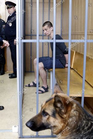 Russia's Political Performance Artist Pyotr Pavlensky (l) in a Cage Prior to Verdict Hearing at the Meshchansky District Court in Moscow Russia 08 June 2016 the Court Found Pavlensky Guilty on the Criminal Case of Damage of Cultural Heritage Object and Sentenced Him to a Penalty in the Amount of of 500 000 Rubles ( Over 6 700 Euro) in November 2015 Pavlensky was Detained in Moscow After He Had Set Fire at the Door of Federal Security Service (fsb) Headquarters During His Action Under the Name of 'Threat' Russian Federation Moscow