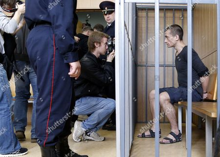 Stock Image of Russia's Political Performance Artist Pyotr Pavlensky (r) in a Cage Prior to Verdict Hearing at the Meshchansky District Court in Moscow Russia 08 June 2016 the Court Found Pavlensky Guilty on the Criminal Case of Damage of Cultural Heritage Object and Sentenced Him to a Penalty in the Amount of of 500 000 Rubles ( Over 6 700 Euro) in November 2015 Pavlensky was Detained in Moscow After He Had Set Fire at the Door of Federal Security Service (fsb) Headquarters During His Action Under the Name of 'Threat' Russian Federation Moscow
