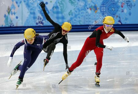 Emily Scott (c) of the Usa Falls While Shim Suk Hee (l) of South Korea and Fan Kexin of China Skate to 1st and 2nd Place Respectively in the Third Quarter Final in the Womens' 1000m of Short Track Event in the Iceberg Skating Palace at the Sochi 2014 Olympic Games Sochi Russia 21 February 2014 Russian Federation Sochi