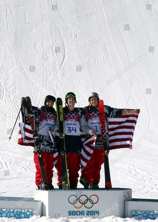 (l-r) Silver Medal Winner Gus Kenworthy Gold Medal Winner Joss Christensen Bronze Medal Winner Nicholas Goepper All of the Usa Celebrate During the Flower Ceremony of the Men's Freestyle Skiing Slopestyle Final in the Rosa Khutor Extreme Park at the Sochi 2014 Olympic Games Krasnaya Polyana Russia 13 February 2014 Russian Federation Krasnaya Polyana
