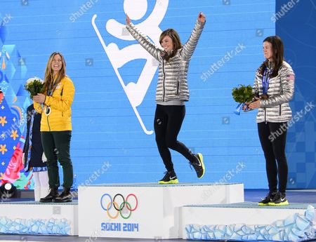Gold Medalist Kaitlyn Farrington (c) of Usa is Flanked by Silver Medalist Torah Bright (l) of Australia and Bronze Medalist Kelly Clark of Usa During the Medal Ceremony For Snowboard Women's Halfpipe Event at the Sochi 2014 Olympic Games Sochi Russia 13 February 2014 Russian Federation Sochi