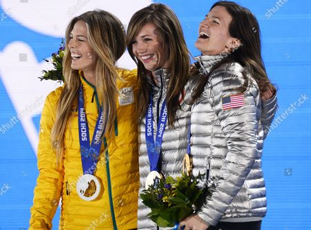 Stock Photo of Gold Medalist Kaitlyn Farrington (c) of Usa is Flanked by Silver Medalist Torah Bright (l) of Australia and Bronze Medalist Kelly Clark of Usa During the Medal Ceremony For Snowboard Women's Halfpipe Event at the Sochi 2014 Olympic Games Sochi Russia 13 February 2014 Russian Federation Sochi