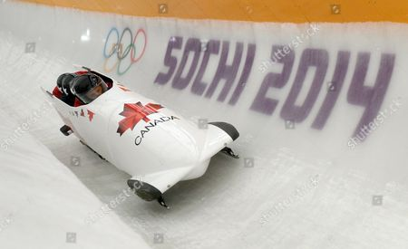 Pilot Lyndon Rush of Canada and His Push Athletes in Action During a Training Session For the Men's Four-man Bobsleigh at the Sanki Sliding Center at the Sochi 2014 Olympic Games Krasnaya Polyana Russia 06 February 2014 Russian Federation Krasnaya Polyana
