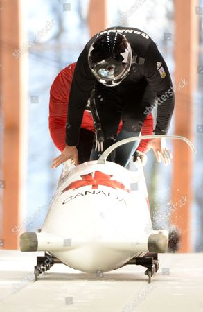 Pilot Lyndon Rush of Canada and His Push Athlete at the Start During the Men's Two Men Bobsleigh Training Session at the Sochi 2014 Olympic Games Krasnaya Polyana Russia 06 February 2014 Russian Federation Krasnaya Polyana