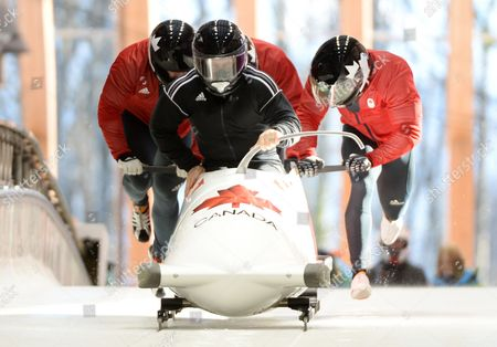 Pilot Lyndon Rush of Canada and His Push Athletes at the Start During the Men's Four Man Bobsleigh Training Session at the Sochi 2014 Olympic Games Krasnaya Polyana Russia 06 February 2014 Russian Federation Krasnaya Polyana
