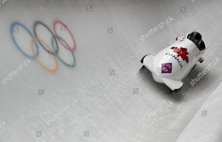 Lyndon Rush and Lascelles Brown of Canada in Action During the First Run of the Two-man Bobsleigh Competition at the Sanki Sliding Center at the Sochi 2014 Olympic Games Krasnaya Polyana Russia 16 February 2014 Russian Federation Krasnaya Polyana