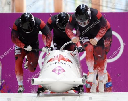 Lyndon Rush Lascelles Brown David Bissett Neville Wright of Canada at the Start of the Four-man Men's Bobsleigh Heat 3 Competition in Sliding Center Sanki at the Sochi 2014 Olympic Games Krasnaya Polyana Russia 23 February 2014 Russian Federation Krasnaya Polyana