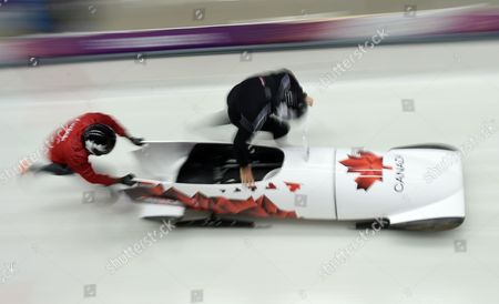 Pilot Lyndon Rush of Canada and His Push Athlete During the Two-man Bobsleigh Training Session at the Sochi 2014 Olympic Games Krasnaya Polyana Russia 14 February 2014 Russian Federation Krasnaya Polyana