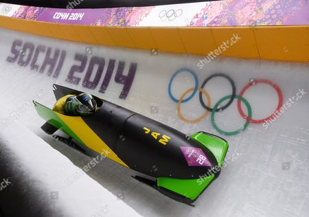 Winston Watts and Marvin Dixon of Jamaica in Action During the Second Run of the Two-man Bobsleigh Competition at the Sanki Sliding Center at the Sochi 2014 Olympic Games Krasnaya Polyana Russia 16 February 2014 Russian Federation Krasnaya Polyana