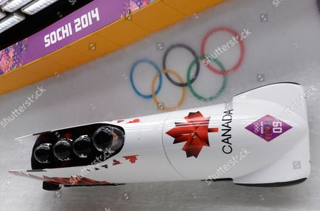 Lyndon Rush Lascelles Brown David Bissett Neville Wright of Canada in Action During the Four-man Men's Bobsleigh Heat 1 Competition in Sliding Center Sanki at the Sochi 2014 Olympic Games Krasnaya Polyana Russia 19 February 2014 Russian Federation Krasnaya Polyana