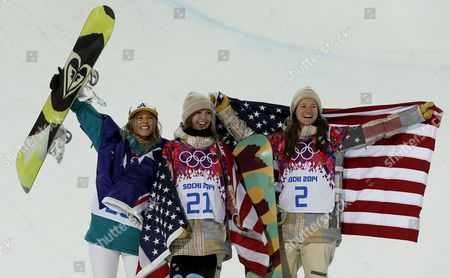(l-r) Silver Medalist Torah Bright of Australia Gold Medalist Kaitlyn Farrington of the Usa and Bronze Medalist Kelly Clark of the Usa Celebrate During the Flower Ceremony For the Women's Snowboard Halfpipe Competition at Rosa Khutor Extreme Park During the Sochi 2014 Olympic Games Krasnaya Polyana Russia 12 February 2014 Russian Federation Krasnaya Polyana