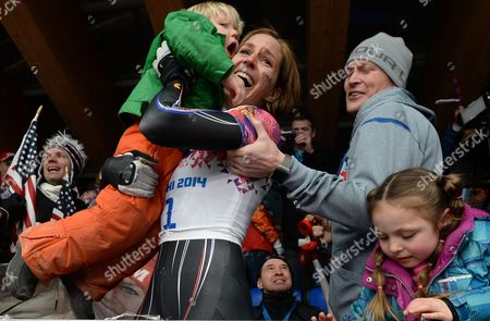 Noelle Pikus-pace of the Usa Celebrates with Her Family Husband Janson Pace Son Traycen and Daughter Lacee After Winning Silver the Women's Skeleton Competition at the Sanki Sliding Center at the Sochi 2014 Olympic Games Krasnaya Polyana Russia 14 February 2014 Russian Federation Krasnaya Polyana
